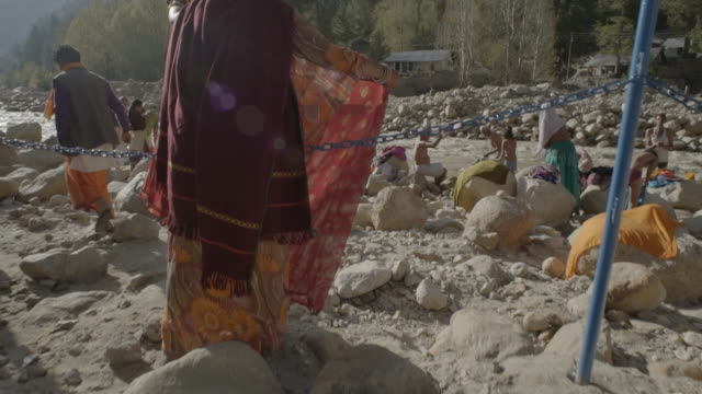 w/s crane up pilgrims in gangotri (source of the ganges river) - taking a bath stock videos & royalty-free footage