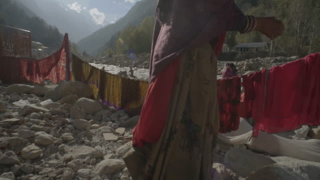 w/s crane up pilgrims in gangotri (source of the ganges river) - religious celebration stock videos & royalty-free footage