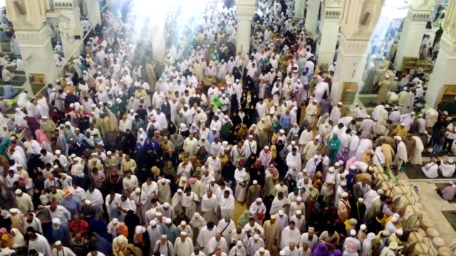 pilgrims moving out after prayer time in side the al haram mosque - moving after stock videos & royalty-free footage