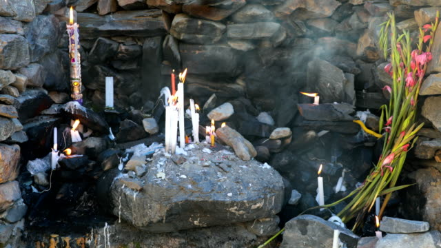 pilgrims pray at a marker along the route to the annual qoyllur rit'i festival on may 27 2018 in ocongate peru every year since 1783 in the sinakara... - religious music stock videos and b-roll footage