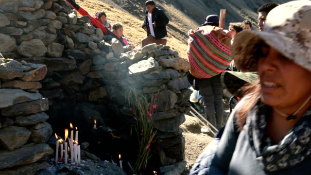 pilgrims pray at a marker along the route to the annual qoyllur rit'i festival on may 27, 2018 in ocongate, peru. every year, since 1783 in the... - religious celebration stock videos & royalty-free footage