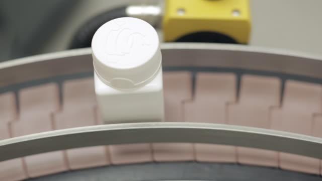 A Pill Bottle Moving Along a Conveyor Belt