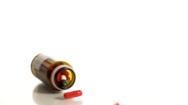 HD SLOW MOTION: Pill Bottle Rolling On A Glass