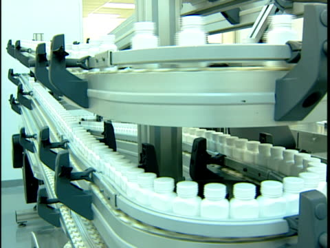 ms pill bottles moving on manufacturing production line in pharmaceutical factory / new jersey, usa - pharmaceutical manufacturing machine stock videos & royalty-free footage