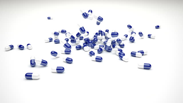pill capsules falling - capsule medicine stock videos and b-roll footage