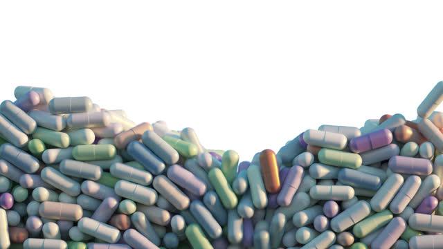 vidéos et rushes de pill capsules pour into the box and then pour out of it. - vitamine a