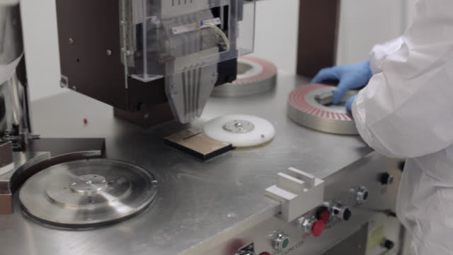 pill encapsulation machine - changing the rotary disc - pharmaceutical manufacturing machine stock videos & royalty-free footage