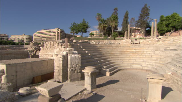 pillars, plinths and stone walls remain in alexandria, egypt. - amphitheatre stock videos & royalty-free footage