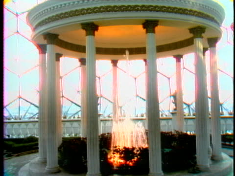 pillars surround a small fountain that bubbles within montreal's biosphere. - music or celebrities or fashion or film industry or film premiere or youth culture or novelty item or vacations stock videos & royalty-free footage