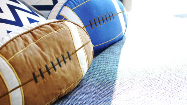 vídeos de stock e filmes b-roll de pillow as football shape - suavidade