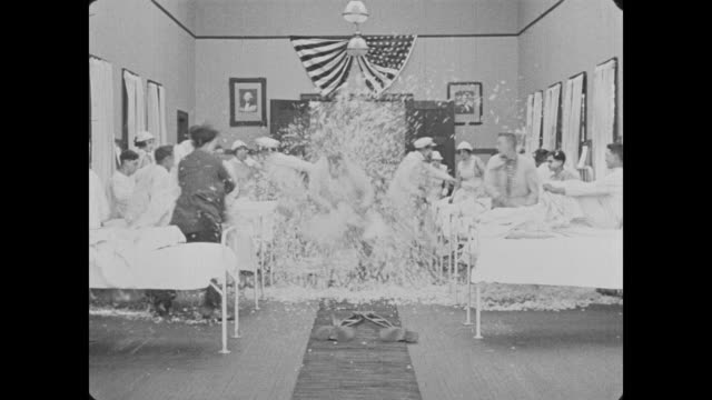 1918 pillow fight in hospital ward - kopfkissen stock-videos und b-roll-filmmaterial