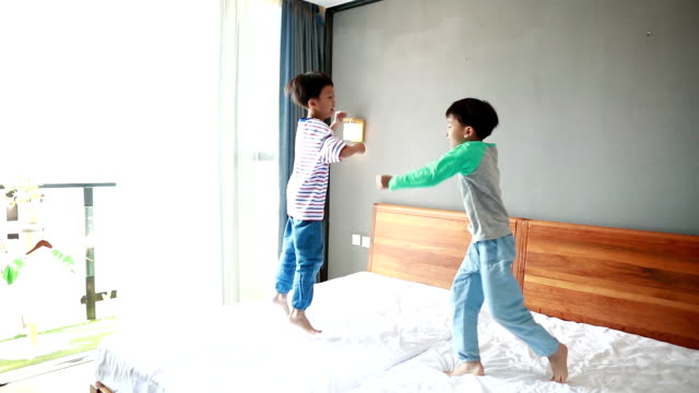 pillow fight - bedclothes stock videos & royalty-free footage