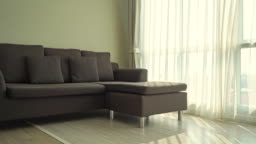 Pillow on sofa with electric light lamp decoration interior of living room