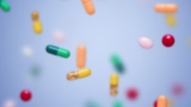 CU LA SELECTIVE FOCUS Pills and capsules falling