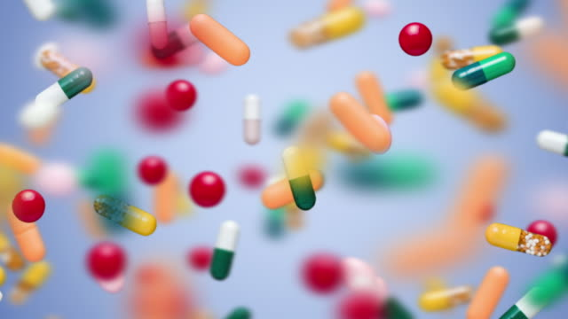 CU SELECTIVE FOCUS Pills and capsules floating in air