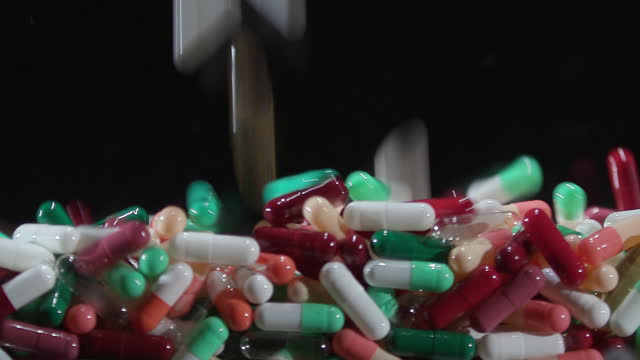 pills falling down and stacking up - dependency stock videos & royalty-free footage