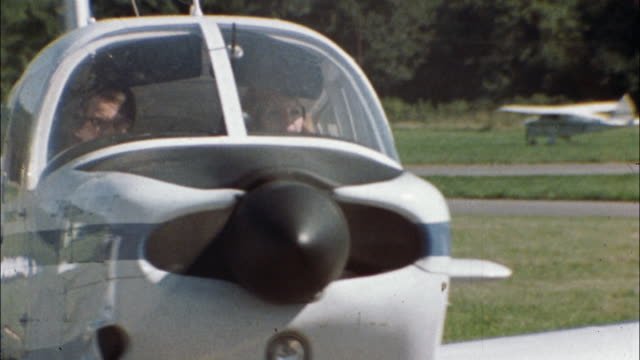 a pilot and her passengers arrive and park a small plane on the tarmac. - captain stock videos and b-roll footage