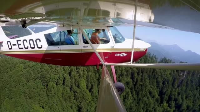 ld pilot and his passenger flying in the light aircraft on a sunny day - abundance stock videos & royalty-free footage
