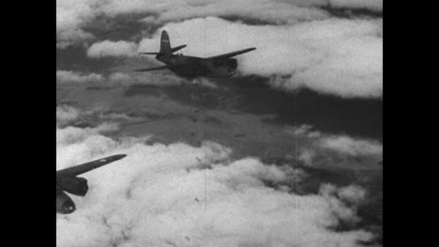 pilot at controls in cockpit / rear shot formation of bombers drops bombs / from int plane as bombs drop out of bomb bay; ground is visible below /... - world war ii stock videos & royalty-free footage