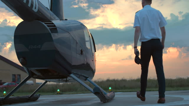 pilot boarding the helicopter - helicopter pilot stock videos & royalty-free footage