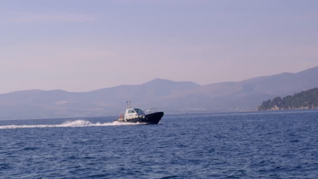 4k pilot boat moving on sunny blue ocean, real time - pilot stock videos & royalty-free footage