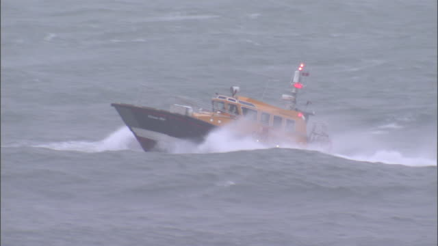 a pilot boat navigates over huge waves during a storm. - rough stock videos & royalty-free footage