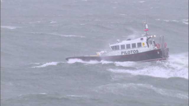 a pilot boat navigates over huge waves during a storm. - ship stock videos & royalty-free footage