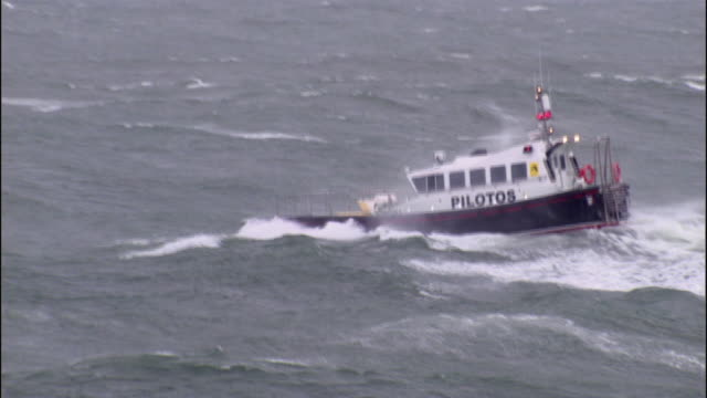 WS TS Pilot boat traverses huge waves on stormy sea / County Cork, Munster, Ireland