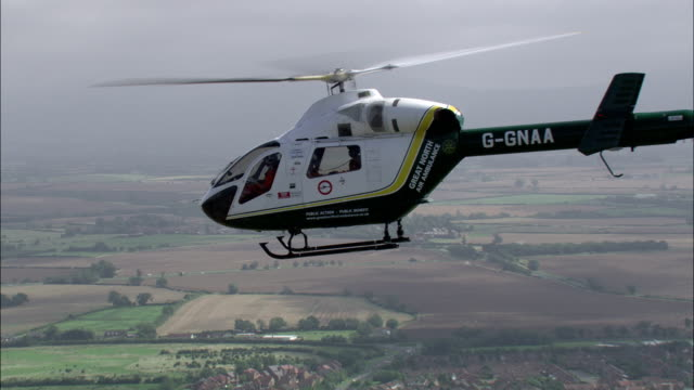 A pilot carefully flies an air ambulance helicopter. Available in HD.