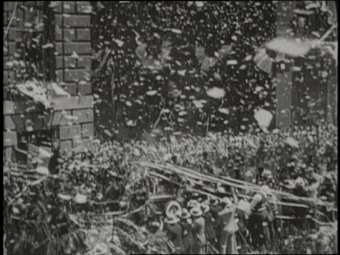 Pilot Charles Lindbergh rides through New York City in a huge celebratory parade