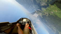 SPEED UP POV: Pilot controlling the glider and doing loops in the sunny sky