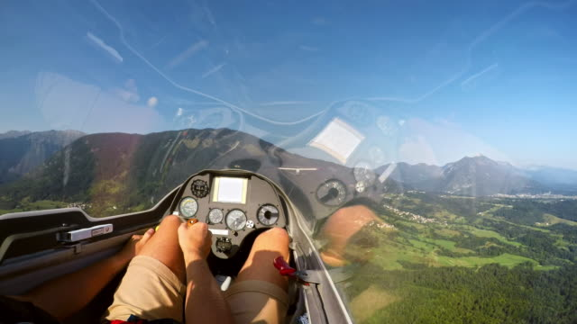 pov pilot controlling the glider while being towed into the air by a light plane on a sunny day - glider stock videos & royalty-free footage