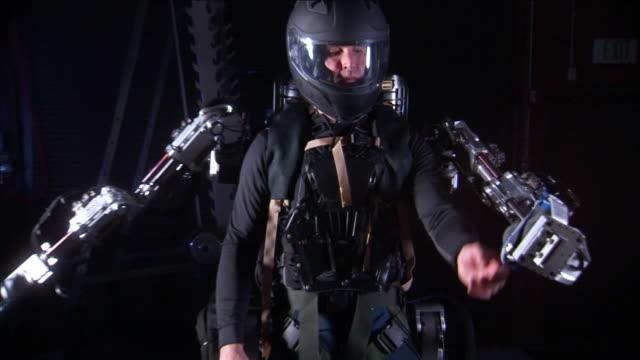 a pilot demonstrates exoskeleton arm motion. - exoskeleton stock videos & royalty-free footage