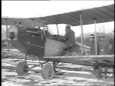 pilot descending from biplane / ground crew standing around a biplane - chillicothe stock videos & royalty-free footage
