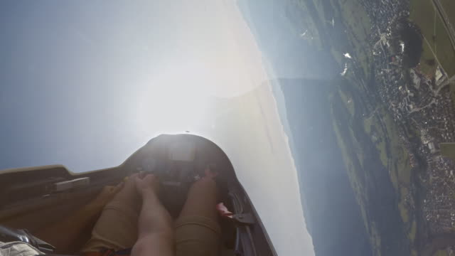 pov pilot doing upside down stunts in the glider on a sunny day - glider stock videos & royalty-free footage