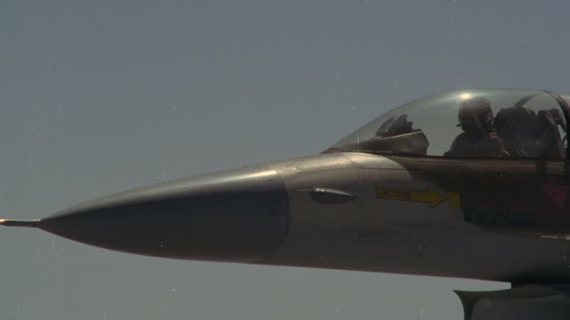 A pilot flies an F-16 fighter jet.