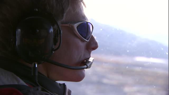 a pilot flies over alaska. - air vehicle stock videos & royalty-free footage