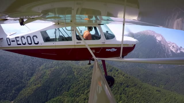 ld pilot flying a light aircraft above a forest in sunshine - private airplane stock videos & royalty-free footage