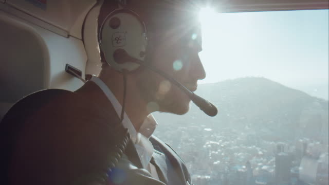 pilot flying helicopter - helicopter stock videos & royalty-free footage