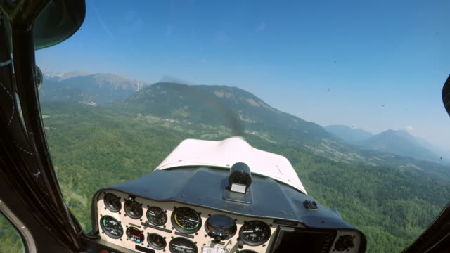 pov pilot flying his light plane flying above a forest in sunshine - private airplane stock videos & royalty-free footage