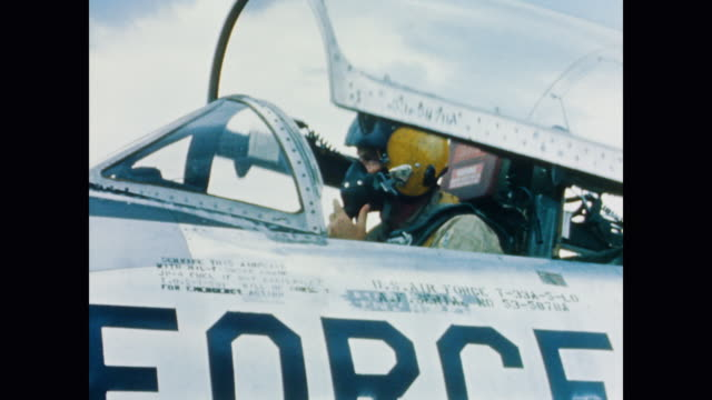 a pilot gets situated in the cockpit before closing the lid of his airplane - 1958 stock videos & royalty-free footage