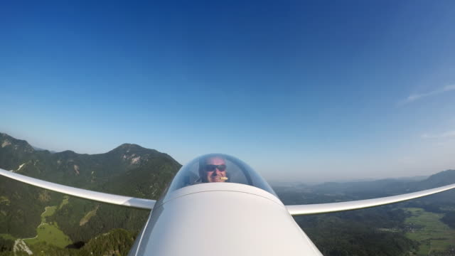 ld pilot in a sailplane talking while flying high in sunshine - glider stock videos & royalty-free footage
