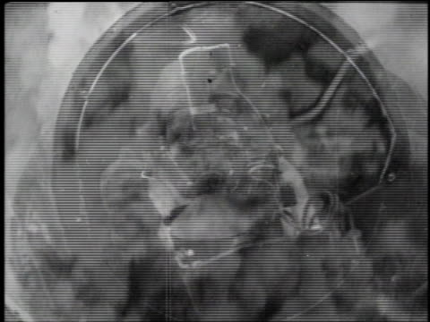 pilot in flight helmet presses trigger on joystick / aerial string of bombs striking the landscape below and exploding / aerial bombs exploding on... - d dagen bildbanksvideor och videomaterial från bakom kulisserna