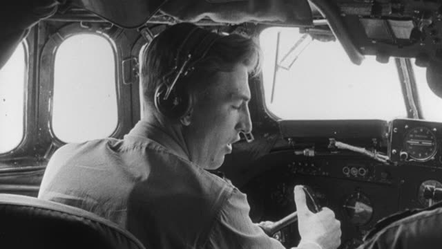 1950 montage pilot in the cockpit and view below the aircraft's wing / united kingdom - pilot stock videos and b-roll footage