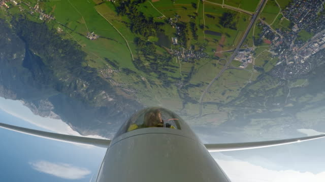 ld pilot in the cockpit of a glider turning upside down above the sunny countryside - glider stock videos & royalty-free footage