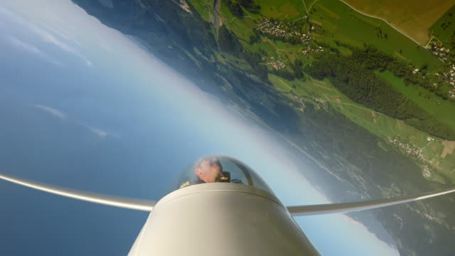 speed up: pilot in the glider smiling while looping in the sunny sky - glider stock videos & royalty-free footage
