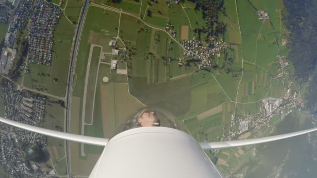 ld pilot in the glider turning upside down in the sky on a sunny day - captain stock videos & royalty-free footage
