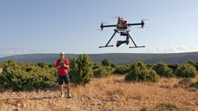 pilot lifting a drone into the air - film crew stock videos & royalty-free footage
