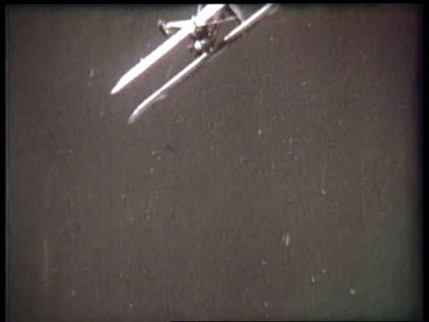 a pilot maneuvers a biplane during an airshow. - acrobatica aerea video stock e b–roll