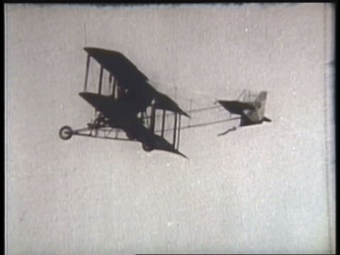 a pilot maneuvers a biplane in an airshow. - scientific experiment stock videos & royalty-free footage